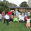 Christ the King Commemorative Mass : People gathered on the lawn and driveway between the Cathedral of Christ the King rectory and Peachtree Road during the Aug. 15 Mass observing the 75th anniversary of Christ the King's first Mass.